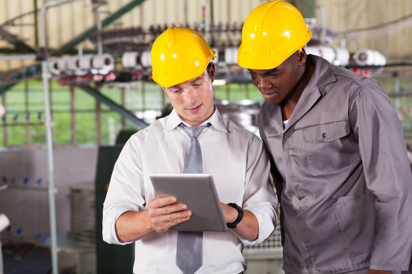 factory manager and worker on mobile